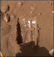 Phoenix lander trench on Mars (NASA via Associated Press)